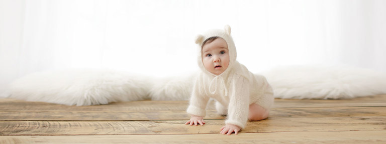 baby girl in bear suit