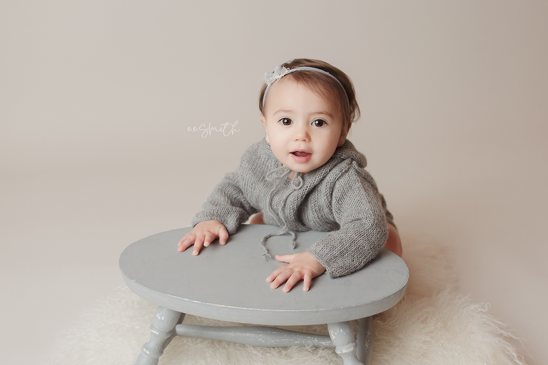 Baby girl in grey knit hoodie