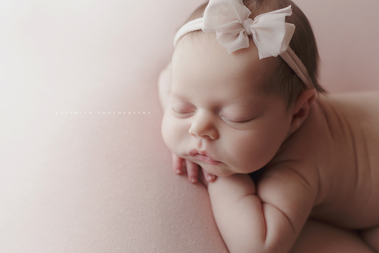 Newborn baby girl on pink goodnight moon wisp bow