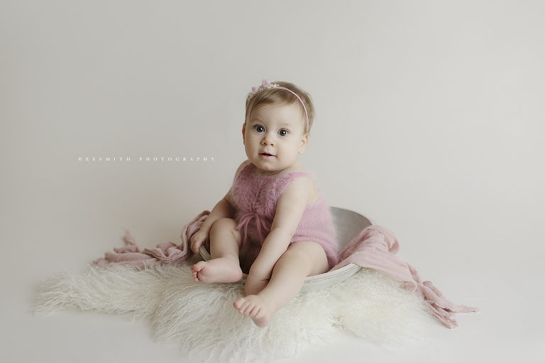 baby girl in pink romper - ginger n pickles knits